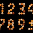 Numeral font formed of multicoloured tea candles (isolated on bl — Stock Photo