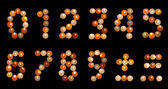 Numeral font formed of multicoloured tea candles (isolated on bl — Stockfoto