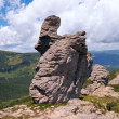 Stony figure on mountain ridge — Stock Photo