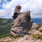 Stony figure on mountain ridge — Stock Photo