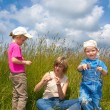 Family in tallgrass — Stock Photo