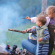 Family near campfire — Stock Photo