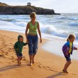 Family on surf beach — Stock Photo