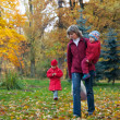 Family in autumn park — Stock Photo #8026828
