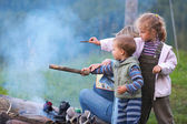 Family near campfire — Stock Photo