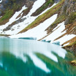 Reflections on the summer alpine lake — Foto Stock