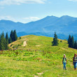 Summer mountain plateau landscape and family - Stock Photo