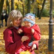 Family in autumn park - Stock Photo