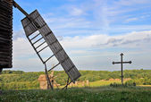 Windmill and cross — Stock Photo