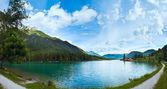 Alpine summer lake panorama — Stock Photo