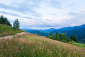 Evening mountain and family on hill — Stock Photo