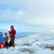 Family on autumn mountain plateau with first winter snow — Stock Photo #8796615