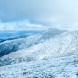 First winter snow on autumn mountain plateau — Stock Photo #8796644