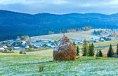 First winter snow and autumn mountain village — Foto Stock
