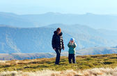 Family make photo on autumn mountain plateau — Stock Photo