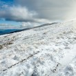 First winter snow on autumn  mountain plateau — Stock Photo