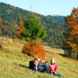 Family in autumn mountain — Stock Photo #9137628