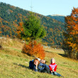 Family in autumn mountain — Stock Photo