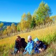 Family walk on autumn mountain Nimchich pass — Stockfoto #9573851