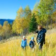 Family walk on autumn mountain Nimchich pass — Stock Photo #9703715