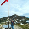 Austrian Flag above Alps mountain — Stockfoto
