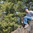 Man and his dog on a rock — Stock Photo #10121077