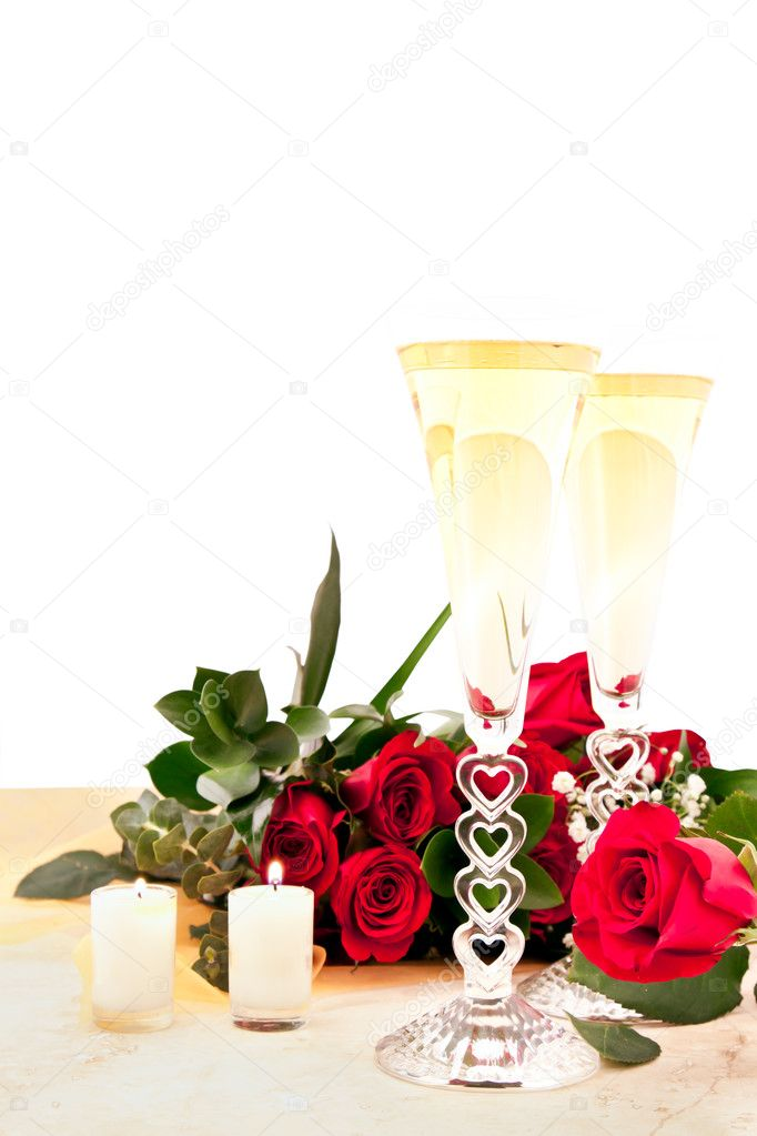 Red roses and champagne on a slate countertop with two candles lit for valentines — Stock Photo #8419747