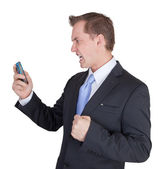 Business man angry at the phone — Stock Photo