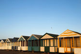 Beach huts in golden sunlight — Stock Photo