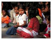 Pretty girl from India watching performances of students in school, — Stock Photo