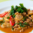 Stock Photo: Delicious fried pork, onion, chili, vegetables and green herbs