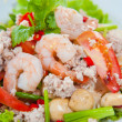 Thai dressed spicy salad with prawn, pork, green herbs and nuts : delicious - Stock Photo