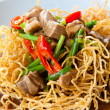 Stock Photo: Chinese style deep fried yellow noodles with pork, chili, vegetables and so