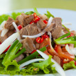 Spicy salad with pork and green herb in Thai style — Stock Photo