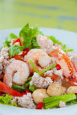 Thai dressed spicy salad with prawn, pork, green herbs and nuts : delicious — Stock Photo