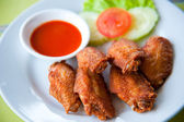 Deep fried spicy chicken wing with chili sauce — Stock Photo