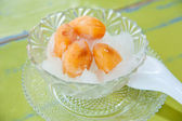 A sweet preserve zalacca in syrup and ice : famous and delicious thai style — Stock Photo