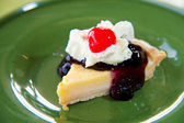 Blueberry cheesecake with cream and red jelly : delicious sweet and dessert — Foto de Stock