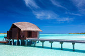 Overwater villas in blue lagoon of an island — Stock Photo