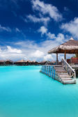 Jetty with steps into tropical blue lagoon — Stock Photo
