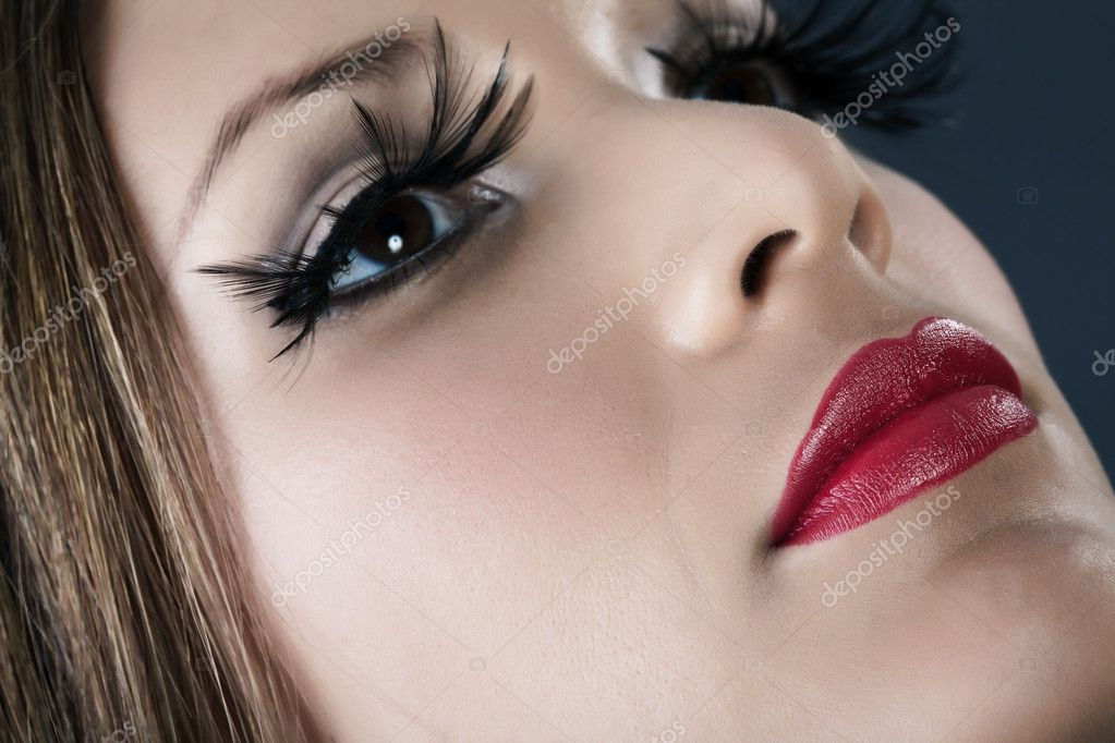 Close-up portrait of young model with red lips make-up — Stock Photo #10353987