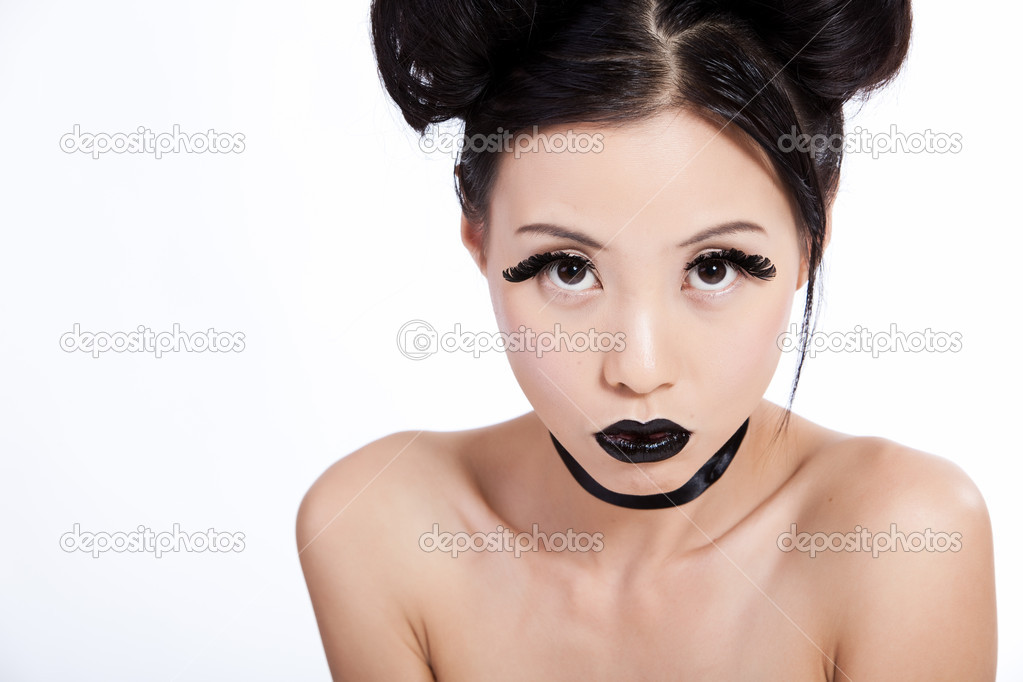 Young asian female with creative black makeup looking  Stock Photo #10362581