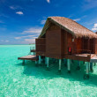 Over water bungalow with steps into tropical lagoon — Stock Photo