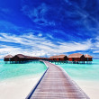 Overwater villas on the lagoon - Stock Photo