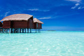 Overwater bungalow in lagoon around tropical island — Stock Photo