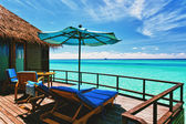 Overwater villa balcony overlooking tropical lagoon — Stock Photo