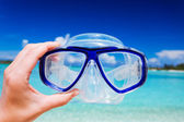 Snorkel googles against beach and sky — Stock Photo