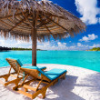 Two chairs and umbrella on tropical beach — Stock Photo