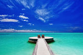 Two deck chairs on stunning tropical beach — Stock Photo