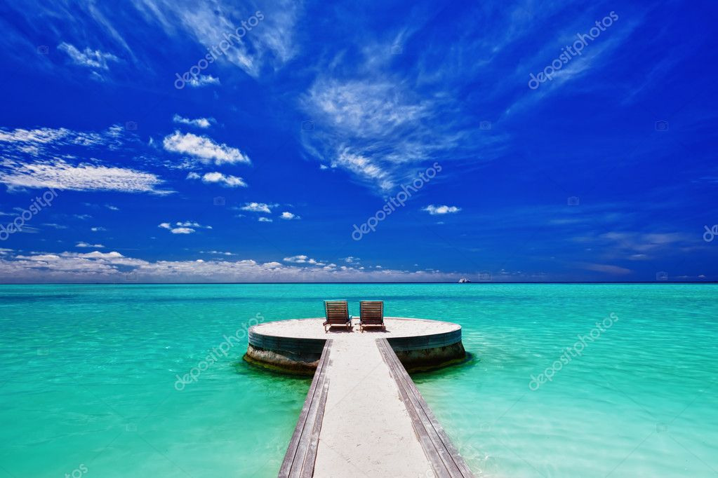 Two deck chairs on stunning empty tropical beach  Stock Photo #9186318